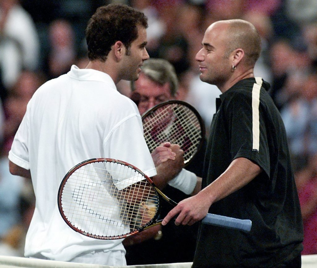 FLUSHING MEADOWS, UNITED STATES:  Number ten seeded Pete Sampras (L) of the US and number two seeded Andre Agassi (R) of the  US shake hands at the net at the end of their match 05 September, 2001, at the US Open in Flushing Meadows, New York. Sampras won 6-7, 7-6, 7-6, 7-6.   AFP PHOTO/Don EMMERT (Photo credit should read DON EMMERT/AFP/Getty Images)