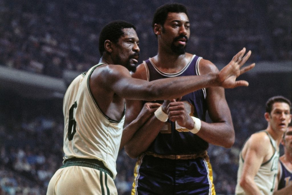 BOSTON - 1968:  Bill Russell #6 of the Boston Celtics defends against Wilt Chamberlain #13 of the Los Angeles Lakers during a game played in 1968 at the Boston Garden in Boston, Massachusetts. NOTE TO USER: User expressly acknowledges and agrees that, by downloading and or using this photograph, User is consenting to the terms and conditions of the Getty Images License Agreement. Mandatory Copyright Notice: Copyright 1968 NBAE (Photo by Dick Raphael/NBAE via Getty Images)