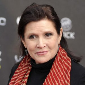 """FILE - This April 7, 2011 file photo shows Carrie Fisher at the 2011 NewNowNext Awards in Los Angeles. Fisher says she's coming back as Princess Leia for the new """"Star Wars"""" films. The actress confirmed that she'll return as the iconic character in an interview posted Wednesday, March 6, 2013, with Florida's Palm Beach Illustrated. Casting for the films has yet to be announced, but Fisher answered a simple """"yes"""" when asked if she would be reprising Leia. (AP Photo/Chris Pizzello, file)"""