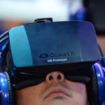 An attendee wears an Oculus Rift HD virtual reality head-mounted display at he plays EVE: Valkyrie, a multiplayer virtual reality dogfighting shooter game, at the Intel booth at the 2014 International CES, January 9, 2014 in Las Vegas, Nevada. AFP PHOTO /ROBYN BECK        (Photo credit should read ROBYN BECK/AFP/Getty Images)