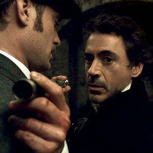 """SHH-FP-023 (L-r) JUDE LAW as Dr. John Watson and ROBERT DOWNEY JR. as Sherlock Holmes in Warner Bros. Pictures' and Village Roadshow Pictures' action-adventure mystery """"Sherlock Holmes,"""" distributed by Warner Bros. Pictures."""