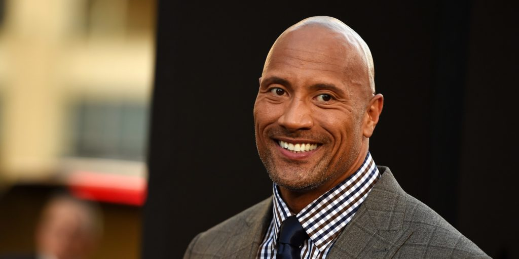 """Actor Dwayne Johnson attends the premiere of """"Hercules,"""" July 23, 2014 at TCL Chinese Theatre in Hollywood, California.  AFP PHOTO / Robyn Beck        (Photo credit should read ROBYN BECK/AFP/Getty Images)"""