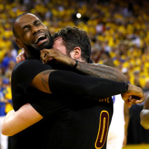 OAKLAND, CA - JUNE 19:  LeBron James #23 and Kevin Love #0 of the Cleveland Cavaliers celebrate after defeating the Golden State Warriors 93-89 in Game 7 of the 2016 NBA Finals at ORACLE Arena on June 19, 2016 in Oakland, California. NOTE TO USER: User expressly acknowledges and agrees that, by downloading and or using this photograph, User is consenting to the terms and conditions of the Getty Images License Agreement.  (Photo by Ezra Shaw/Getty Images)
