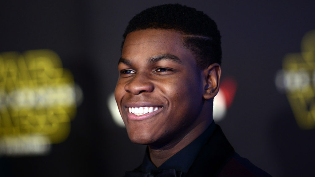 "HOLLYWOOD, CA - DECEMBER 14:  Actor John Boyega arrives for the Premiere Of Walt Disney Pictures And Lucasfilm's ""Star Wars: The Force Awakens""  held on December 14, 2015 in Hollywood, California.  (Photo by Albert L. Ortega/Getty Images)"