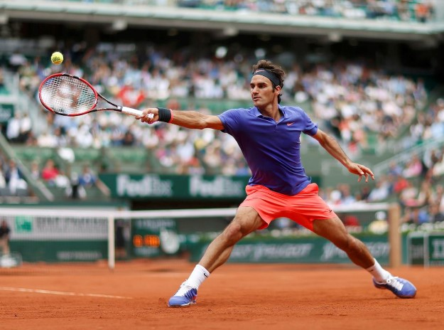 Roger Federer of Switzerland plays a shot to Alejandro Falla of Colombia during their men's singles match at the French Open tennis tournament at the Roland Garros stadium in Paris