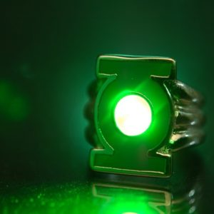 """Close-up of Green Lantern's power ring. The glow was achieved by shining a green laser at the center of the symbol.  This image is straight out of the camera: no tweaking, no color processing, no cropping, no nothing.  Photo submitted to the Flickr group Macro Mondays for the """"Ring"""" theme.  --  Want more? jdhancock.com 