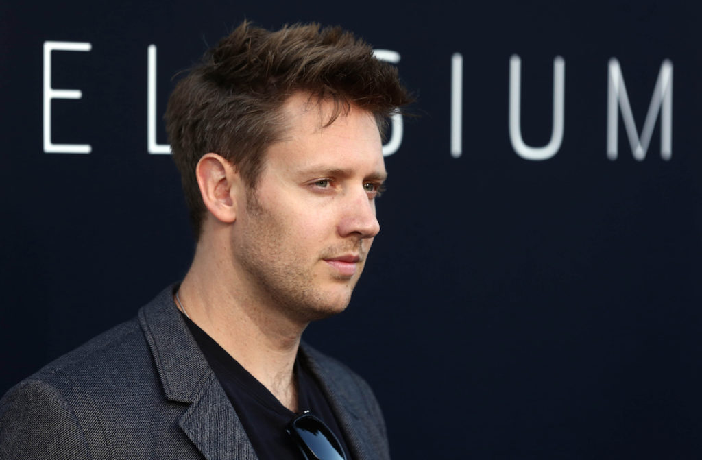 """Writer and director Neill Blomkamp arrives at the world premiere of """"Elysium"""" at the Regency Village Theater on Wednesday, Aug. 7, 2013 in Los Angeles. (Photo by Matt Sayles/Invision/AP)"""