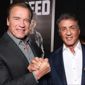 "WESTWOOD, CA - NOVEMBER 19:  Arnold Schwarzenegger (L) and Producer Sylvester Stallone attend the premiere of Warner Bros. Pictures' ""Creed"" at Regency Village Theatre on November 19, 2015 in Westwood, California.  (Photo by Todd Williamson/Getty Images)"