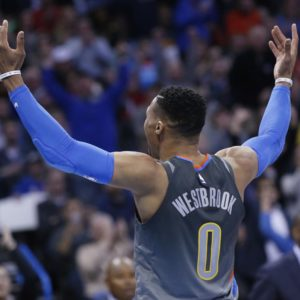 Oklahoma City Thunder guard Russell Westbrook (0) gestures to the crowd following a dunk against the Washington Wizards during the fourth quarter of an NBA basketball game in Oklahoma City, Thursday, Jan. 25, 2018. (AP Photo/Sue Ogrocki)