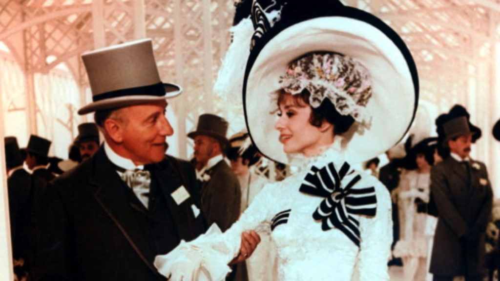 TITLE: MY FAIR LADY ¥ PERS: HYDE WHITE, WILFRED / HEPBURN, AUDREY ¥ YEAR: 1964 ¥ DIR: CUKOR, GEORGE ¥ REF: MYF001GU ¥ CREDIT: [ THE KOBAL COLLECTION / WARNER BROS ]